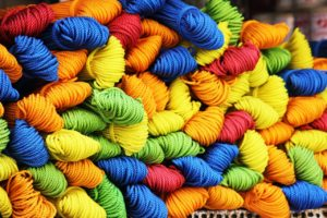 Multicolored Jumbled Threads Used to Create a Beautiful Tapestry